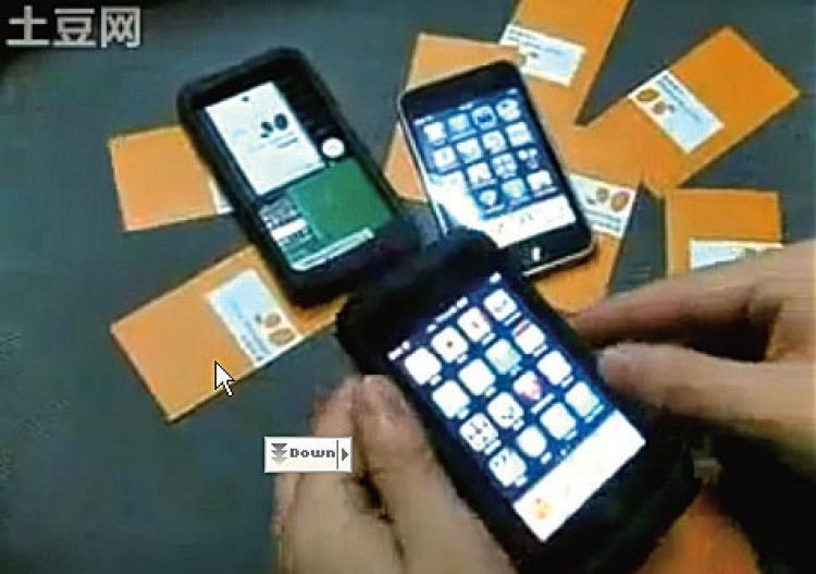 The Apple Peel, a highly sought-after product in China that instantly transforms an iPod Touch into an iPhone.  (Screen shot from tudou.com)
