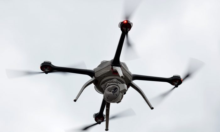 An unmanned surveillance drone flies at the Defence and Security Equipment International (DSEI) arms fair at the ExCeL centre in east London, on September 10, 2013. (BEN STANSALL/AFP/Getty Images)