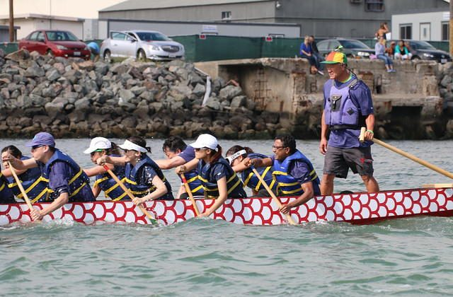 "Norm Gok steers at the annual San Francisco International Dragon Boat Festival on Treasure Island in 2014. ""It's much more than just an individual thing. Dragon boating is a real team sport. Everybody has to function together,"" Gok said. (Courtesy of Jeremy Wong)"