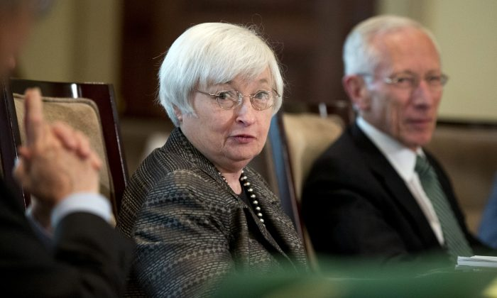Federal Reserve Chair Janet Yellen (L) with Vice Chairman Stanley Fischer, and the board of governors of the Federal Reserve System, presides over a meeting in Washington, on July 20, 2015. (Manuel Balce Ceneta/AP)