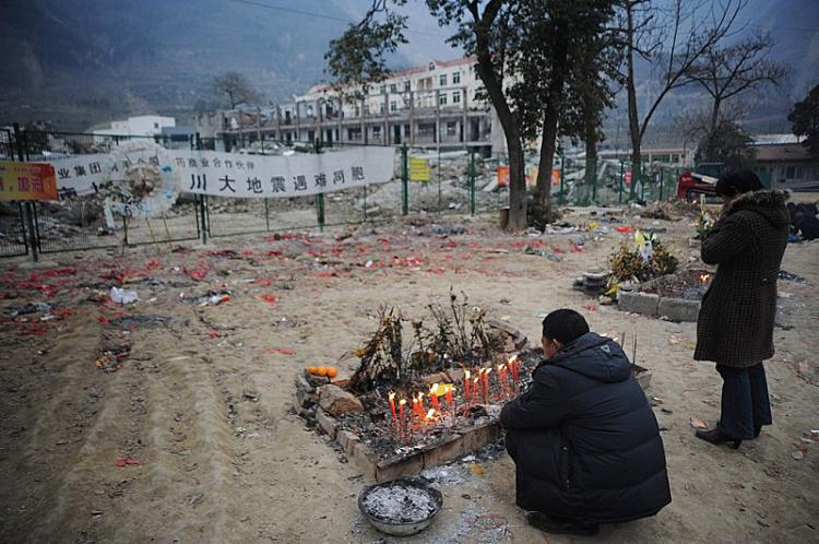 Before the Chinese New Year, some parents burned paper money and incense to memorialize their children, who were killed when the Beichuan Middle School collapsed during the May 12 earthquake.  (China Photos/Getty Images)
