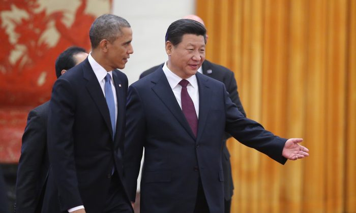 Chinese President Xi Jinping (R) and U.S. President Barack Obama (L) attend a welcoming ceremony inside the Great Hall of the People on November 12, 2014 in Beijing, China. (Feng Li/Getty Images)