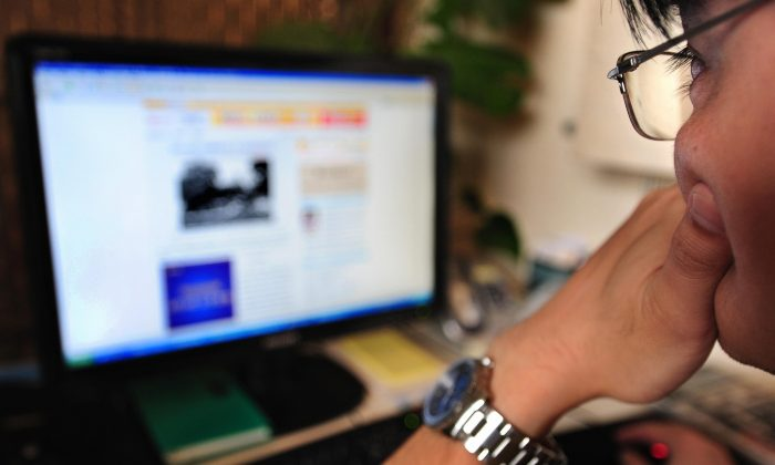 A man thinks while surfing the internet in Beijing on June 15, 2009. Whether China can develop the institutions to allow innovation will determine its economic future, says economist Ma Guangyuan. (Frederic J. Brown/AFP/Getty Images)