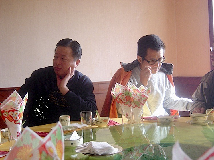Chinese human rights lawyers Gao Zhisheng (L) and Guo Feixiong pictured in a restaurant in January 2006. (The Epoch Times)