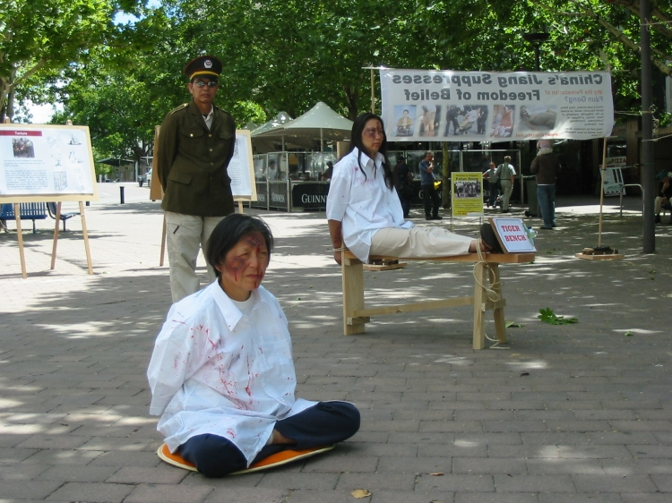 A re-enactment of torture in Canberra similar to that experienced by The Epoch Times journalists. (The Epoch Times)