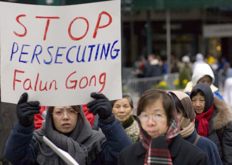 In this file photo, Falun Gong practitioners living outside of mainland China protest against the persecution of their peers prior to the Beijing Olympics. (Jeff Nenerella/The Epoch Times)