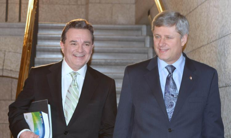 Prime Minister Stephen Harper (R) and Finance Minister Jim Flaherty on Parliament Hill in Ottawa on March 4 to deliver Canada's budget plan for 2010. (The Epoch Times)