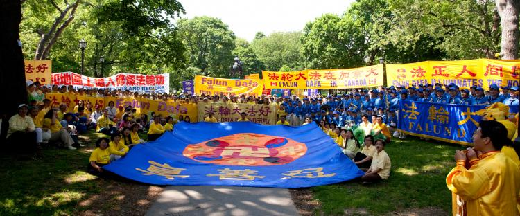 Falun Gong practitioners from across Canada gathered in Toronto on Sunday to hold a rally and a parade aimed at raising awareness about the persecution of their belief in mainland China. (Evan Ning/The Epoch Times)