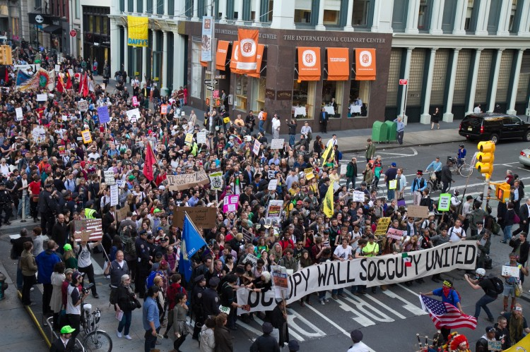 Thousands of Occupy Wall Street protesters march down Broadway toward Wall Street on Monday, forcing police to shut down all the side streets that intersect Broadway on May 1. (Benjamin Chasteen/The Epoch Times)
