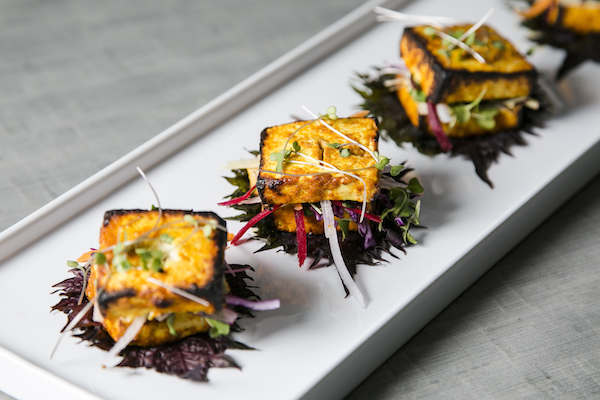 Paneer Tikka, marinated with garam masala and charred in the tandoor, served with ginger, pear, and beet. (Samira Bouaou/Epoch Times)