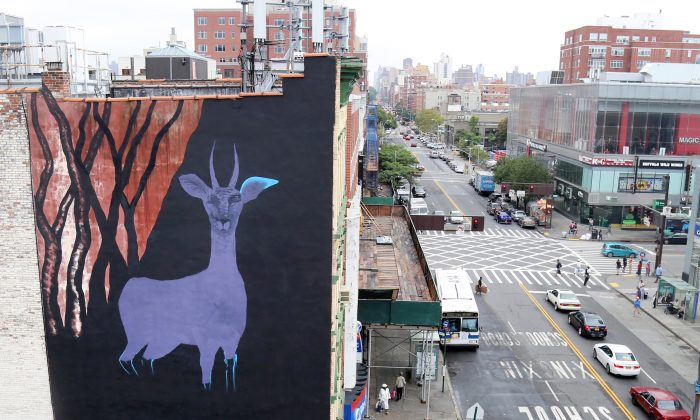 In this Sept. 10, 2015 photo, a large gazelle mural is shown on the side of a building in the Harlem neighborhood of New York. (AP Photo/Mike Balsamo)
