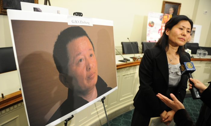 Geng He, the wife of abused Chinese rights lawyer Gao Zhisheng, speaks to the press on Capitol Hill on Jan. 18, 2011 (Tim Sloan/AFP/Getty Images)