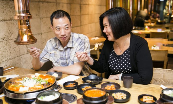 A Korean meal, with communal hot pots and stews, is by nature a  social occasion. (Samira Bouaou/Epoch Times)