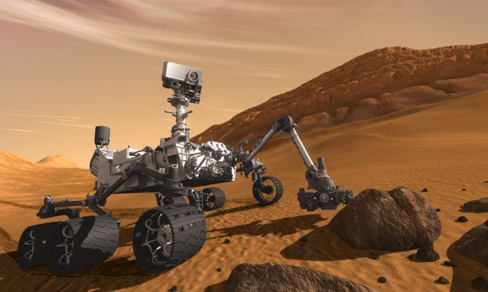 This artist concept features NASA's Mars Science Laboratory Curiosity rover, a mobile robot for investigating Mars' past or present ability to sustain microbial life. (NASA)