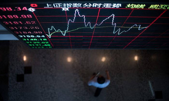 A board shows the stock movements inside the Shanghai Stock Exchange in the Lujiazui Financial district of Shanghai on Sept. 22, 2015. (Johannes Eisele/AFP/Getty Images)