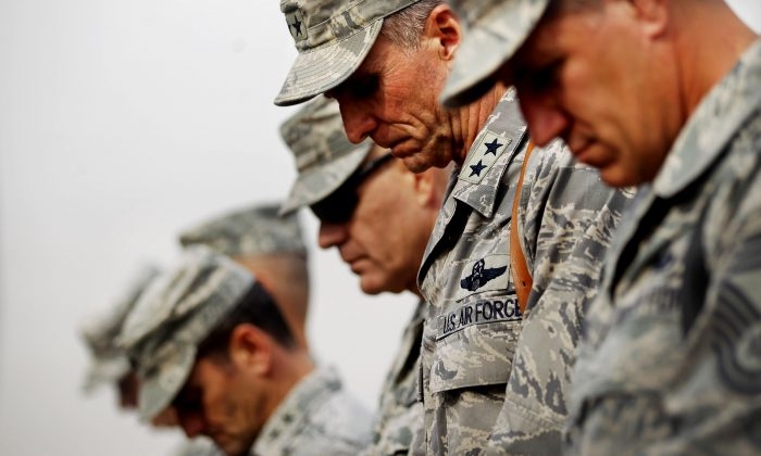 U.S. military personnel bow their heads in prayer during a casing ceremony for the departure of U.S. troops from Iraq at the former Sather Air Base, in Baghdad, Iraq, on Dec. 15, 2011. (Mario Tama/Getty Images)