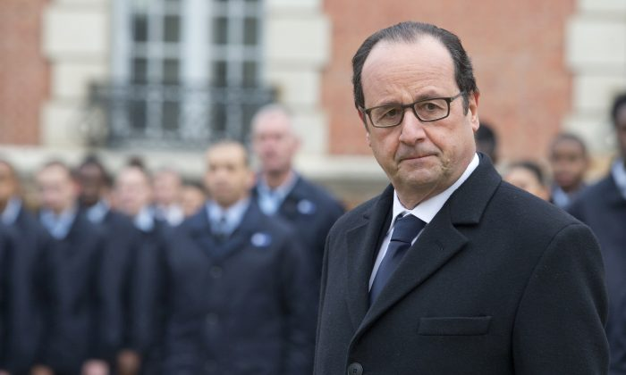 French President Francois Hollande visits a public center for insertion of the Defense (EPIDE) in Montry, France, on Feb. 16, 2015. (AP Photo/Jacques Brinon)