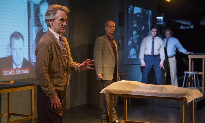"""(L–R) Michael Joseph Mitchell plays investigative reporter Hillel Levin explaining his theory of the assassination of President Kennedy. Mark Ulrich plays Zechariah Shelton, a retired FBI agent , who helps lead the audience through the information. Martin Yurek and Ryan Kitley play all the other characters in """"Assassination Theater."""" (Michael Brosilow)"""