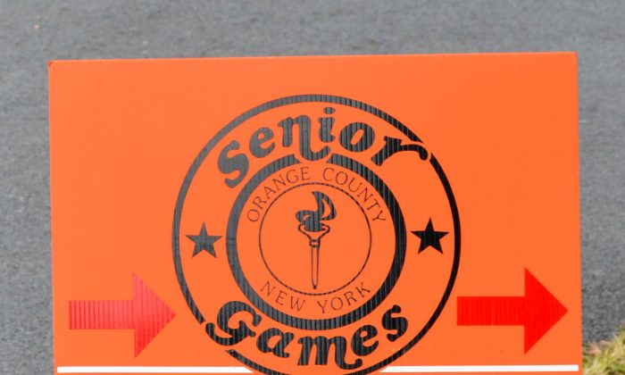 Sign leading to the opening ceremonies of the Orange County Senior Games in Campbell Hall on Sept. 28, 2015.