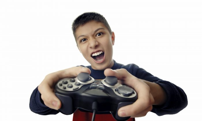 Boy playing a video game. Research shows a strong correlation between violent media consumption and aggressive behavior.  (Zhenikeyev/iStock)