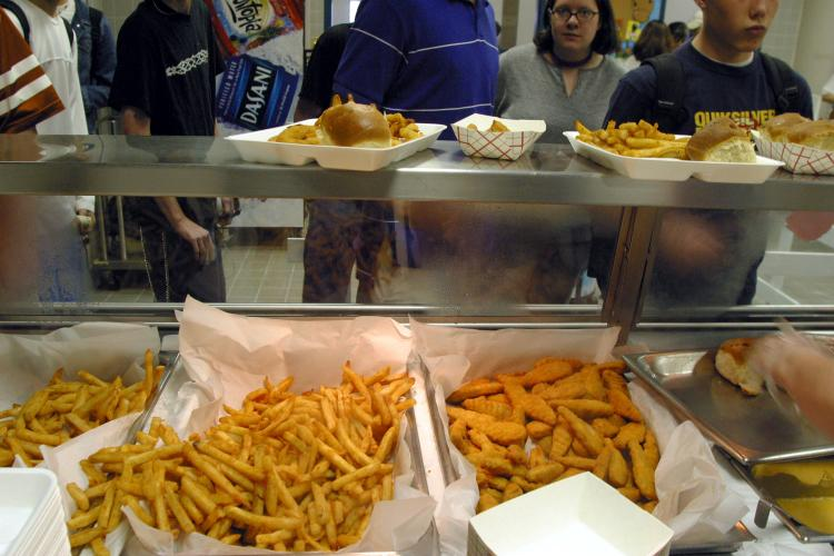 Students line up to receive french fries and chicken tenders during lunch in the cafeteria at a High School in Austin, Texas. The nationwide obesity epidemic has long been a concern of educators, health care professionals, and government agencies at local branches. (Jana Birchum/Getty Images )