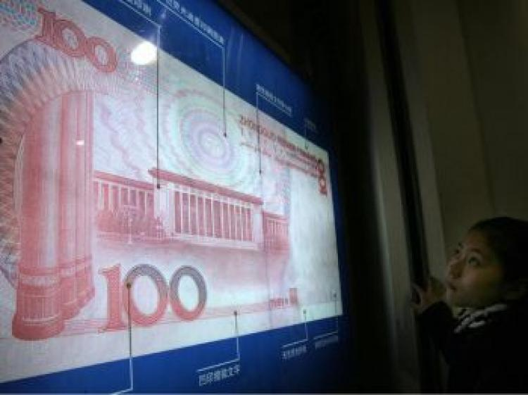 China reported its first trade deficit in six years, but the RMB is still expected to appreciate. (AFP/Getty Image)