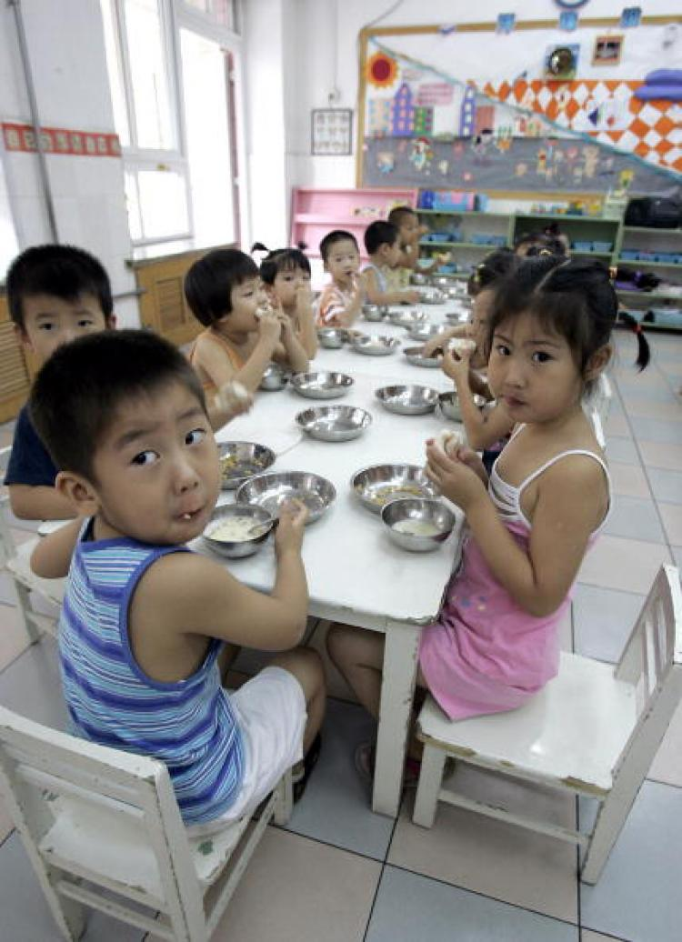 Chinese kindergarten pupils eating breakfast. (Goh Chai Hin/AFP/Getty Images)