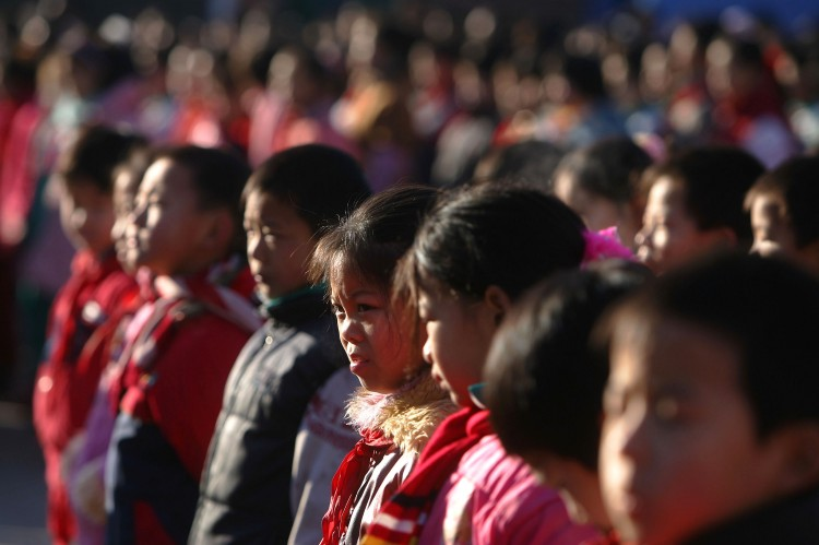 BEIJING, CHINA - DECEMBER 28: Students gather on the playground at Xingzhi Primary School, one of the largest migrant children's schools, on December 28, 2004 in Beijing, China.  (Photo by Cancan Chu/Getty Images)