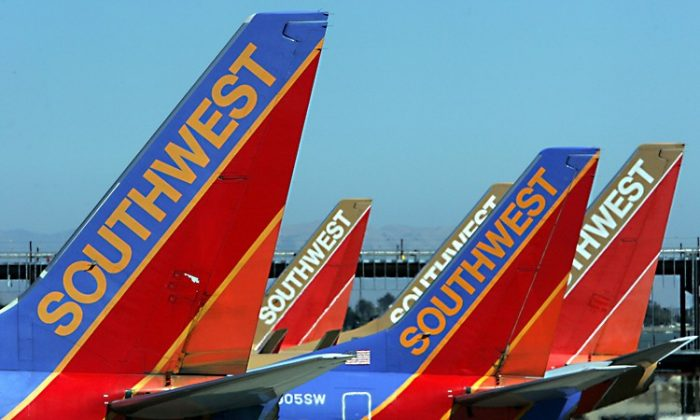 The tail sections of Southwest Airlines planes are seen at the Oakland International Airport in this file photo from 2005. Southwest, along with other airlines, entered into derivative financial contracts to hedge, or lock in, a certain price for aircraft fuel intending to offset the volatile nature of fuel prices. (Justin Sullivan/Getty Images)