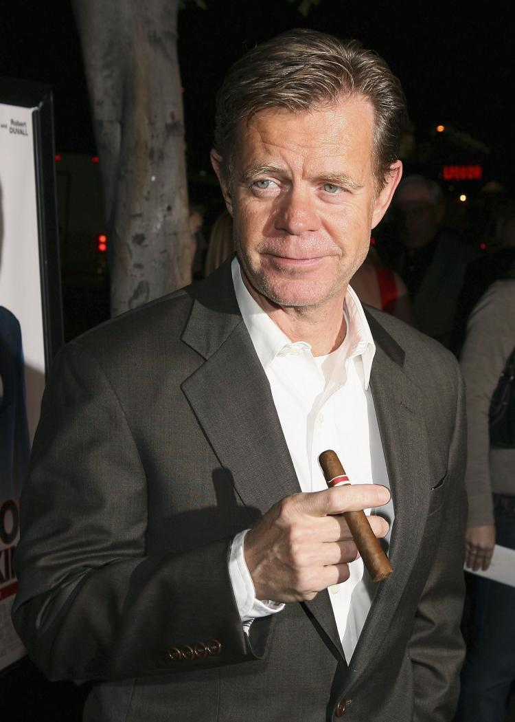 Actor William H. Macy holds a cigar as he arrives at the premiere of Fox Searchlight 'Thank You For Smoking' at the Directors Guild of America in March 2006 in Los Angeles. Health organizations in both Canada and the U.S. want the film industry to cut smoking scenes from youth-rated films.  (Kevin Winter/Getty Images)