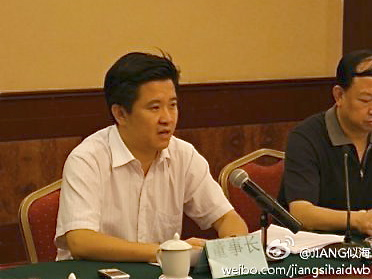 Zhou Shili, speaks to reporters in China.