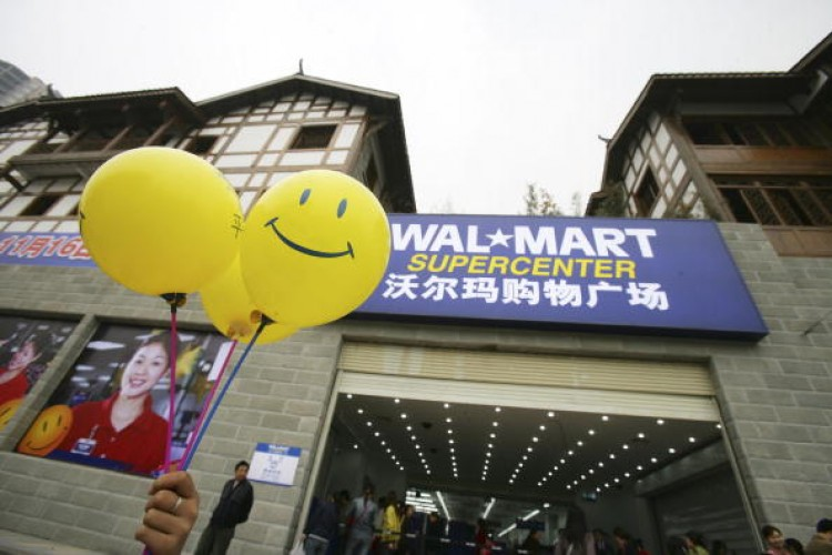 A file photo from 2006 of the grand opening of a Wal-Mart store in Chongqing, China. The Chongqing Administration for Industry & Commerce found that three Wal-mart stores  might be selling regular pork as 'green pork.' (China Photos/Getty Images)