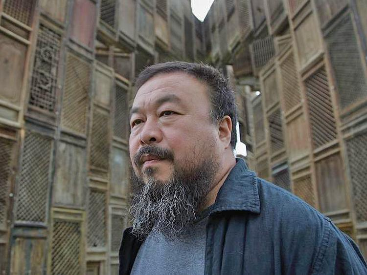 Chinese Artist Ai Weiwei poses in front of his sculpture, 'Template.' Weiwei disappeared by the authorities on April 3, and is reported to have confessed to charges of tax evasion after being tortured in custody. (Simon/Getty Images)
