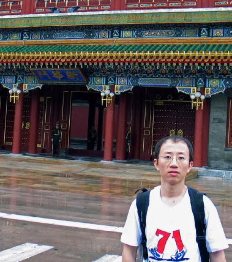 June 2007, Chinese AIDS and pro-democracy activist Hu Jia wears the July 1st protest t'shirt in front of Zhongnanhai, the Chinese leadership compound in Beijing. ( STR/AFP/Getty Images)