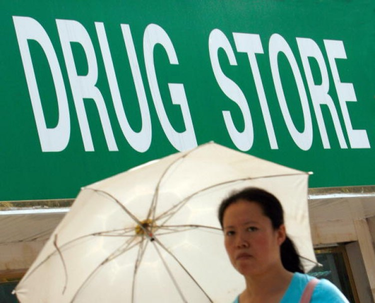 A pedestrian walks past a drug store in Beijing on July 9, 2007. (The Eng Koon/AFP/Getty Images)