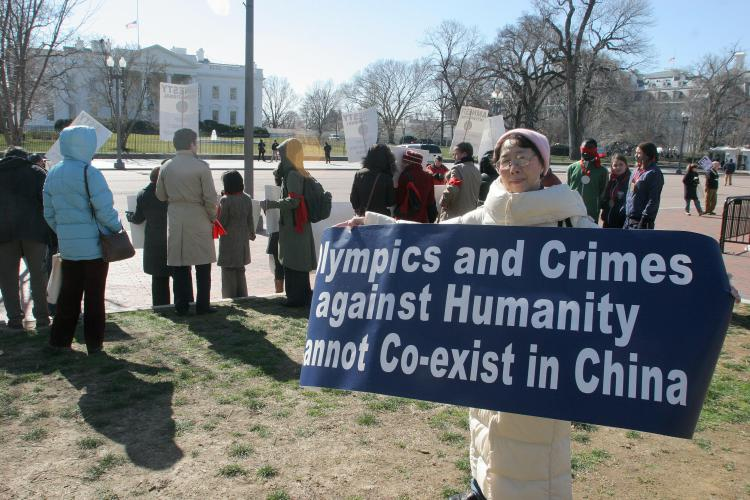 Protesters hold signs outside the White House in Washington,DC on February 11, 2008 during a demonstration organized by Amnesty International calling on China to respect human rights ahead of 2008 summer's Olympic Games. (Nicholas Kamm/AFP/Getty Images)