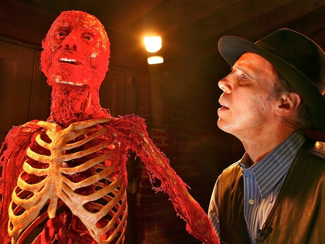 Von Hagens stands next to one of his plastinated bodies