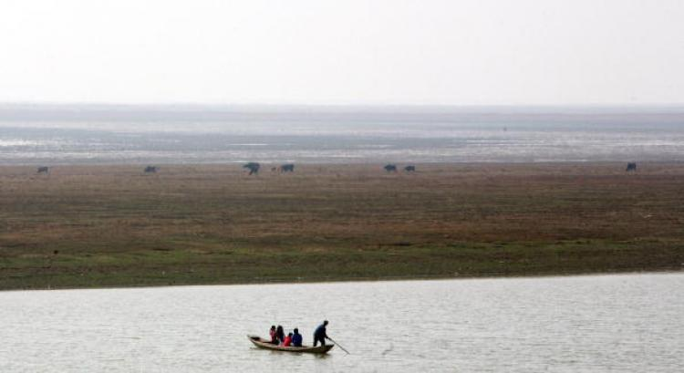 THE EASTERN BERMUDA TRIANGLE: A boat sails in China's Poyang Lake in 2008. Many boats have sunk mysteriously in the Laoye Temple waters of Poyang Lake. (China Photos/Getty Images)