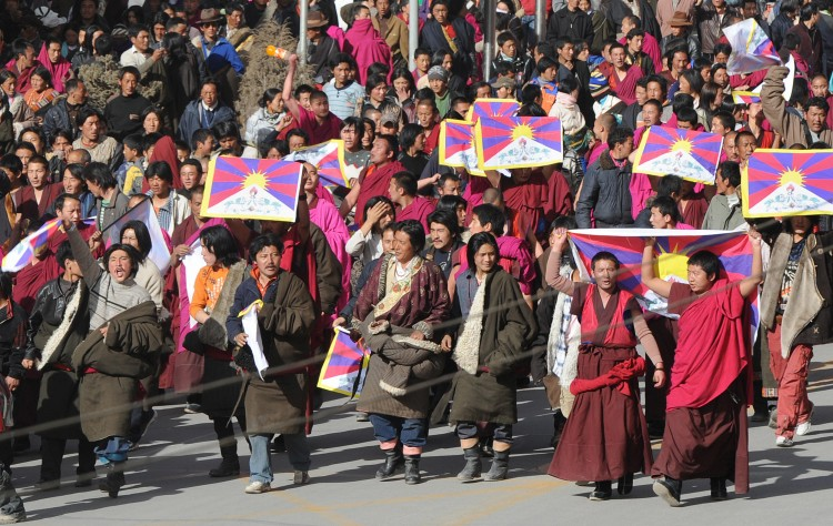 In this picture taken on March 14, 2008, protesters led by Tibetan Buddhist monks shout slogans and carry the Tibetan national flag near Labrang monastery in Gansu Province. Another Tibetan set themselves on fire earlier this week near Labrang in a protest against Chinese rule.  (Mark Ralson/AFP/Getty Images)