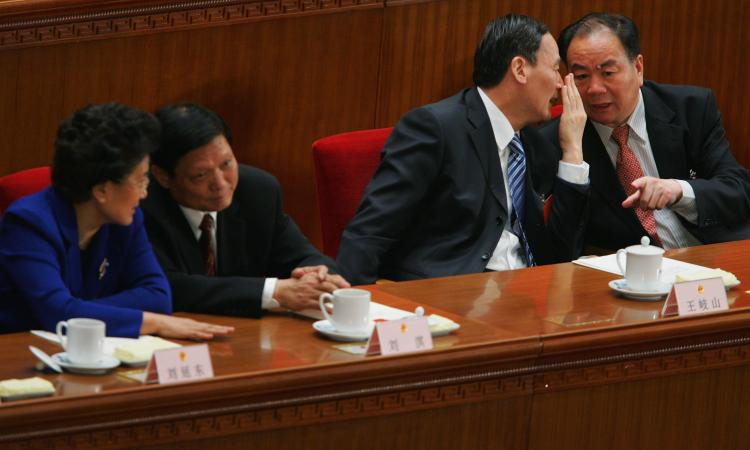 Former Communist Party secretary of Xinjiang Wang Lequan on the right, at the seventh plenary session of the National People's Congress (NPC), in Beijing, March 2008. He stepped down after mass demonstrations recently.  (Feng Li/Getty Images)