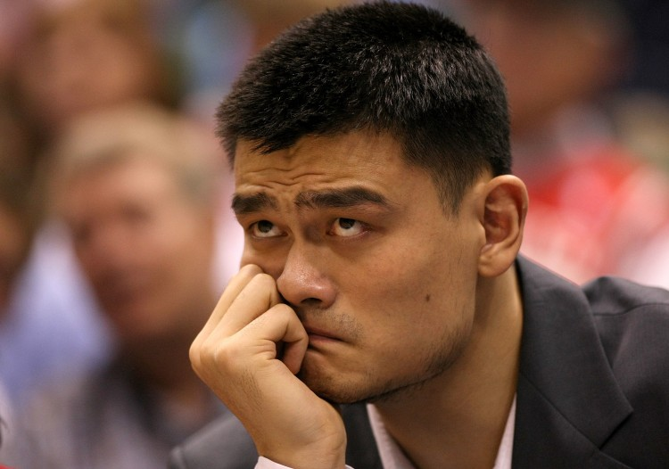 Yao Ming of the Houston Rockets sits injured on the bench during the 2008 NBA Playoffs. Ming announced his retirement from basketball on Wednesday due to prolonged injuries. (Jonathan Ferrey/Getty Images)