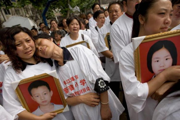 Parents who lost their children in the Sichuan earthquake protest against the inferior government construction quality on June 1, Children's Day. (Andrew Wong/Getty Images)