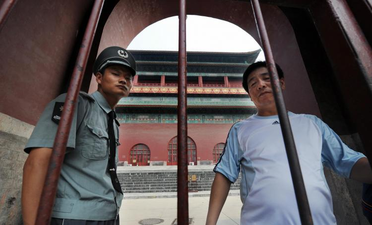 A security guard blocks access to the historic Drum Tower where a U.S. citizen was murdered in Beijing.  (Mark Ralston/AFP/Getty Images   )