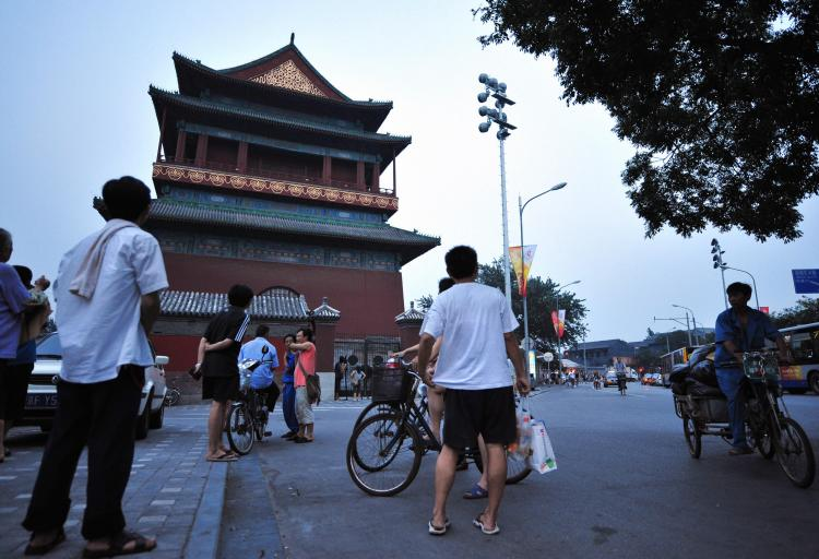 People gather outside Beijing's ancient Drum Tower on August 9, 2008 in Beijing, where a relative of a US Olympic coach was killed and another injured in a stabbing attack earlier in the day. (Frederic J. Brown/AFP/Getty Images)