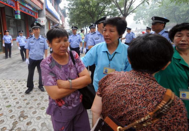A group of Chinese Christians being turned away by police near the Kuanjie Protestant church in Beijing on 10 August 2008, prior to the arrival of US President George W. Bush.  (Goh Chai Hin/AFP/Getty Images)