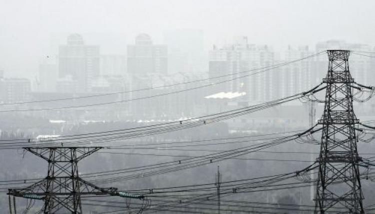 Smog is pictured over Beijing on August 13, 2008, on day 5 of the 2008 Beijing Olympic Games.  (Philippe Huguen/AFP/Getty Images)