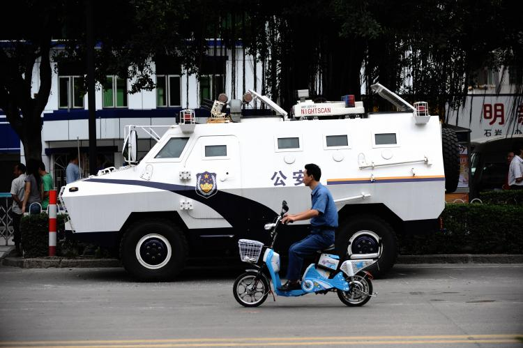 An armoured personel carrier, parked outside a Shenzhen police station that was the center of protests.  (AFP/Getty Images)