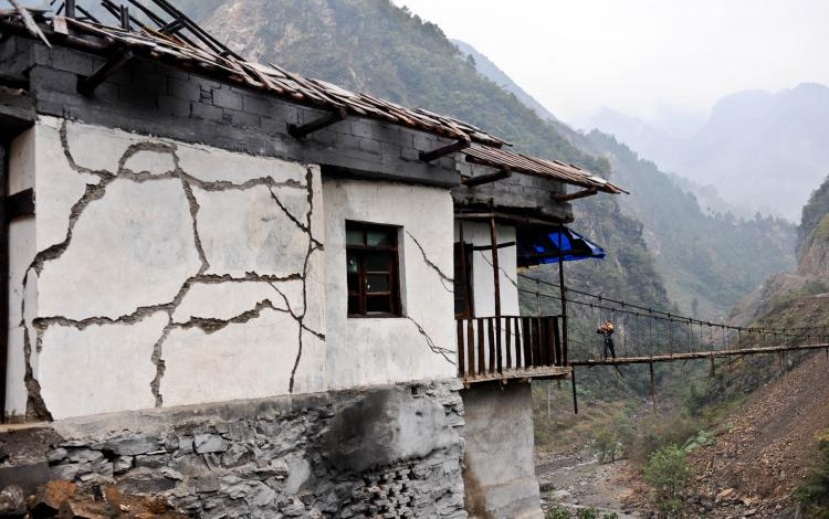 DEVASTATING CONSEQUENCES: A house damaged by the 2008 Wenchuan earthquake. The quake killed or buried approximately 90,000 people. (China Photos/Getty Images)