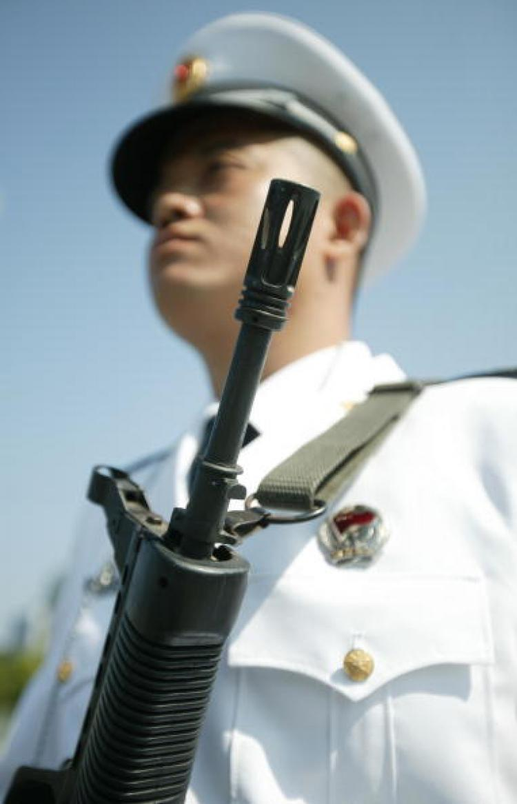 It rarely happens that military personnel are attacked and robbed of their weapon. Xinhua has deleted websites with relevant information. (Alex Hofford/AFP/Getty Images)
