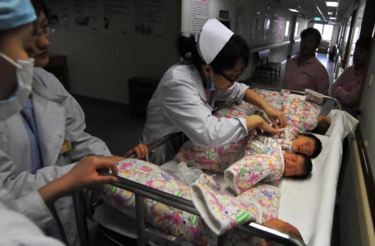 A nurse checks the name tag on newborn babies after they are given a bath and returned to their parents at a hospital in Beijing. A World Health Organization report shows that between October 2007 and May 2008, 46 percent of births in China were by Cesarean section. (Frederic J. Brown/Getty Images)
